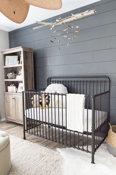 Gender neutral nursery design in white, beige, and gray with a touch of rustic farmhouse style - Neutral Nursery Ideas & Decor