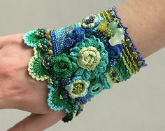 Blue - Green Crochet Cuff With Crocheted Flowers