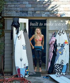 Riding the wave: Pro surfer Quincy Davis, 19, stands next to her surfboards in her Montauk, New York, home