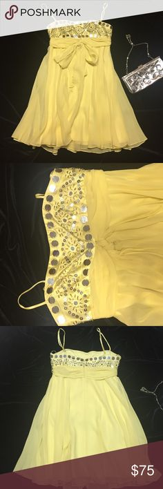 BCBG Maxazria yellow short flowy sequins dress BCBG Maxazria yellow short flowy sequins dress with bow tie attached belt, adjustable spaghetti strap. Gorgeous summer dress. Very very slight stain can easily be removed (see 4th picture) size petite BCBGMaxAzria Dresses Mini