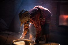 Kathmandu, Nepal:    By Sanjeev Nepali  -    An old woman traditionally spinning and threshing the mustard seeds,,a traditional and unusual process of Mustard Oil harvest.  -      RESOURCE TRAVEL'S TOP 10 TRAVEL PHOTOS OF THE WEEK