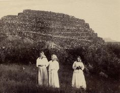 [Portugal/Azores, early 20th century] Three women in white dresses and kerchiefs in front of a stone wall structure. Pico(?). http://75.150.122.156/newbedphoto/default.asp?IDCFile=DETAILSL.IDC,SPECIFIC=180793,LISTIDC=PAGEL.IDC,DATABASE=61009029,