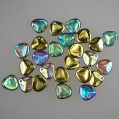 Czech glass rose petals in Crystal Rainbow Golden, 8mm x 7mm. Petal-shaped drop beads in mixed iris shades of blue and green, with a part metallic gold finish. UK seller.