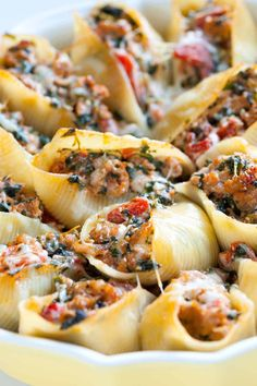 Sausage Stuffed Shells with Spinach. This easy stuffed shells recipe with sausage, spinach, tomato, and ricotta cheese will make just about anyone reach in for more. Sausage Stuffed Shells, Easy Stuffed Shells, Spinach Stuffed Shells, Healthy Stuffed Shells, Stuffed Chicken, Recipe For Stuffed Shells, Barilla Stuffed Shells Recipe, Stuffed Pasta Recipes, Italian Stuffed Shells