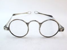 Mid 19th Century silver glasses frames with folding arms