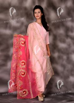 You could go about showing off this fabulous dupatta - suit in kitty parties or any family function .The most attractive part of this suit is its dupatta with a contrast of majenta and baby pink . A beautiful combination of hand and machine work, you would love to have this dupatta -suit in your wardrobe .