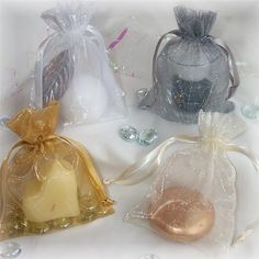 Sheer favor bags from Surroundings.com Favor Bags, Table Centerpieces, Party Favors, Perfume Bottles, Communion, Creative Ideas, Accessories, Tables, Group