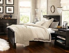 Gray walls with black furniture and light linens idea from Pottery Barn