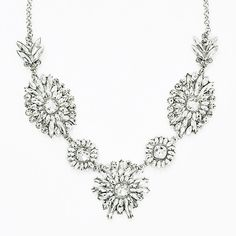 Crystal Brilliant Bib - silver tone floral statement necklace by... (€29) ❤ liked on Polyvore featuring jewelry, necklaces, crystal necklace, crystal stone necklace, bib statement necklace, sparkly necklace and cluster necklace