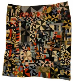 Full Sized Quilt created by Corrine Riley from recycled cashmere sweaters in improvisational style
