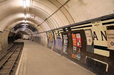 The archetypal 'ghost' station, Aldwych is now so regularly open for tourists that it's in danger of losing its 'abandoned' status. Long-favoured by film and TV companies thanks to its tendency to close at weekends, the station has since become London's default place to film tube scenes – cropping up in V for Vendetta, 28 Weeks Later and Atonement. With an intact platform, plenty of spare track for wandering along and slices of 1990s London still decorating the recesses of its tunnels…