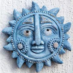 Ceramic sun sign.