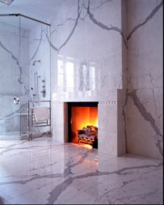 Every bathroom should be clad entirely in marble and have a fire place! #rule