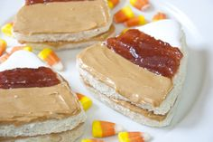 "Candy Corn Peanut Butter Sandwiches  ""Candy corn"" sandwiches made with Smooth Operator peanut butter, strawberry jam, and marshmallow fluff."