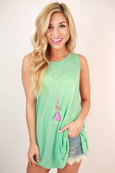 This pretty little top is simple in the front and sexy in the back!
