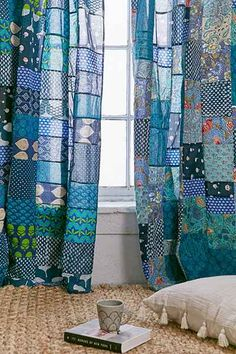 Something like this for kids' rooms. They could make their own.  Magical Thinking patchwork curtain at UrbanOutfitters.com. $34.99 on sale. Turn into quick quilt.