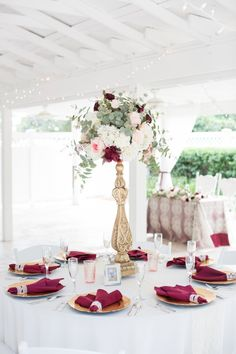 gold and deep red wedding reception decor