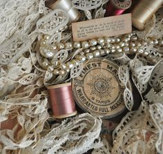 a beautiful mess...antique lace, ribbon, thread, pearls