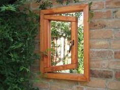 """Magic Garden Mirrors: A Great Way to Enhance an Outdoor """"Room"""" on a Budget"""