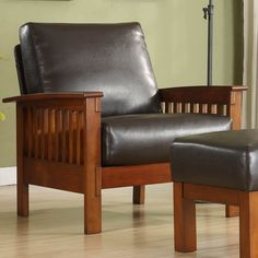This Asian rubber wood brown faux leather armchair combines a series of design styles making it look both contemporary and traditional. Its steam bent arms and bright oak finish displays beauty while its faux leather spring cushions deliver comfort.