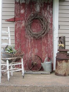 Weathered Red Door With Grapevine Wreath, Milk Can, Wooden Chair, Watering Can, and Iron Wheel #YourNextDeck