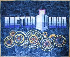 Akiyo Kano crafted this magnificent Doctor Who Quilt. The original site - http://handmadewardrobe.com/2013/04/28/the-doctor-who-gallifreyan-quilt-is-done - is currently down, but I located bits and pieces of her post and images at http://kaitlinguini.tumblr.com/post/61057878979/geekartgallery-doctor-who-gallifreyan-quilt-by and http://mightymega.com/2013/09/16/beautiful-handmade-doctor-who-quilt and http://geekartgallery.blogspot.com/2013/09/crafts-doctor-who-quilt.html