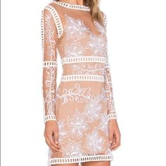 White Lattice Lace Dress Brand new. So angelic and feminine. Perfect for the upcoming holiday seasons. Pair with tights on a colder night out. Best fits size small ladies. Please check last picture for exact measurements. I can preorder in other sizes as well. Not nasty gal just listed for exposure. Nasty Gal Dresses