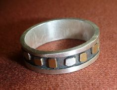 Ring met zilveren en gouden flupsjes