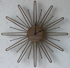 """mid-century inspired clock - Requires a AA battery (included) - Dimensions: 14 1/2 """" x 14 1/2"""" - $119"""
