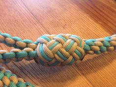 I first made one of these last summer for my dog because I wanted a thicker and more durable dog leash. I used maroon and white as the color...
