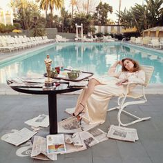 Faye Dunaway surrounded by newspapers at the Beverly Hills Hotel the morning after winning an Oscar for Network in 1971.
