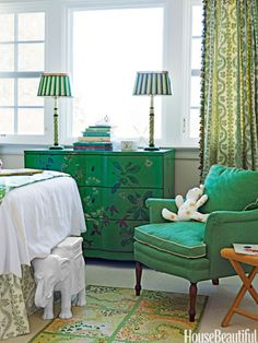 """The inspiration for the girls' room in a Lattingtown, New York, house was their green chest. """"I didn't want it to look super-decorated in here, so the green on the painted lamps doesn't exactly match, although the chair fabric is matched to the bureau,"""" designer Meg Braff says. """"These greens are little-girly but sophisticated enough to grow up with."""""""