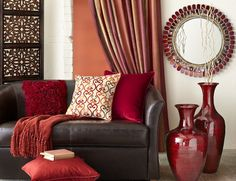 Leo Zodiac: Pier 1 Alluring Mirror with Red Bamboo Vases and assorted pillows