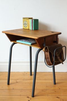 This is a really lovely French school desk with shelf and grey painted legs. The desk is adult height and would work well with one of our