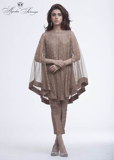 This summer season try the trendy Cape Kurtis. Know the various Cape Style Kurti Designs and patterns that are perfect for any casual occasion. Pakistani Dress Design, Pakistani Outfits, Indian Outfits, Stylish Dresses, Fashion Dresses, Zeina, Cape Dress, Party Wear Dresses, Indian Designer Wear