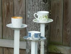 Tea cup bird feeder.  Made 3 of these! So easy and so much cheaper than what people ask for them!! We made the bottom of one with a leg from a chair and the other two with a vase and dowels!!