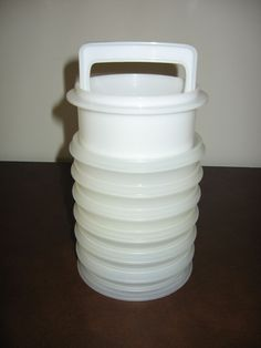 Vintage Tupperware Hamburger Press & Freezer Containers  I still have mine. Love it!