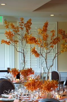 In going with the comfort food and fall theme, look at these gorgeous manzanita branches draped with orange orchids. Very fall inspired and perfect for a larger event.