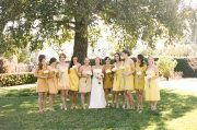 Different shades of yellow. The one to the right of the bride Christina is wearing.