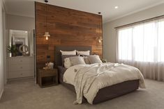 This statement wood panelled feature wall cleverly hides a generous walk in robe - stylish and functional!