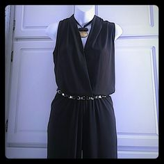 Michael Kors jumpsuit. Michael Kors chocolate brown sleeveless jumpsuit. Snap closure in front and side pockets. Elastic waist. Belt included. Material is 95% polyester and 5% elastin. NWT! Michael Kors Pants Jumpsuits & Rompers