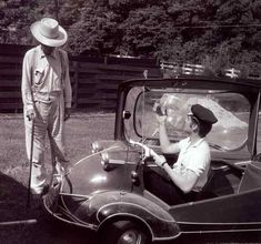 """Elvis on May 1956 in the backyard of his 1034 Audubon Drive home in Memphis,TN, with his three-wheeled Messerschmitt """"bubble car"""" and Harley-Davidson motorcycle, and former Tupelo neighbor, Dan Shackleford. Photo by Phillip Harrington for LOOK magazine. Rare Elvis Photos, Elvis Presley Photos, Rock And Roll, Tupelo Mississippi, Heartbreak Hotel, Look Magazine, Family Photo Album, Memphis Tennessee, Thats The Way"""