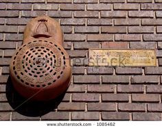 stock photo : Antique fire alarm gong with sign on old brick wall