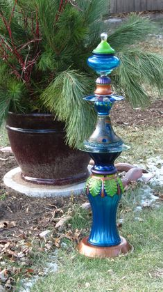 I want to stack and paint glass now! The Peacock Hand-painted glass garden totem by Second Glass Garden Art.