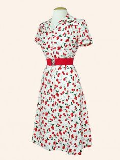 Wonderful dress for everyday use.  With red spectator pumps, a white bolero sweater, a red leather purse, and a red and white picture hat with cherries.  Scrumptious!