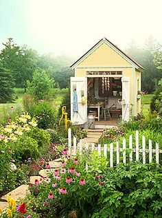 Yellow shed with green & white trim.  This one has vertical paneling lines. Beautiful garden cottage shed