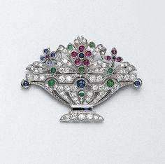 PLATINUM, DIAMOND AND COLORED STONE BROOCH Numerous diamonds approx 1.35 cts. Art Deco or Art Deco style.