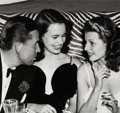 Bruce Cabot, Gloria Vanderbilt and Rita Hayworth at the El Morocco Night Club, November 1941.