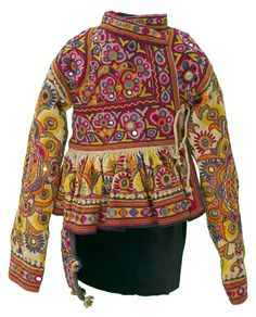 This boy's jacket has such long arms that the garment seems to have been created for a special occasion. In the exuberant Rabari style of northern India, the ground cloth is almost completely covered with shisha, or mirror work, and densely embroidered flowers. Textile Museum of Canada