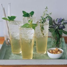 Don't let an abundance of herbs go to waste. Pluck several types of sprigs -- we used basil, mint, and thyme -- and we use them to flavor a basic sugar syrup. Mix the concoction with ice and sparkling water, then garnish the drinks with additional sprigs.